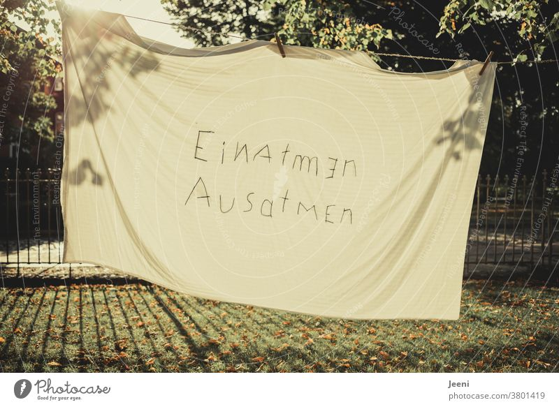 """""""Breathing in"""" on a sheet by the clothesline Inhalation exhale Breathe Air Breathe in Corona Pandemic Life Freedom Sun Shadow Joy Back-light Autumn Light"""