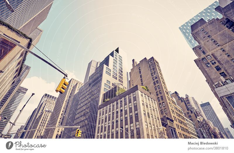 Manhattan diverse architecture, New York City, USA. city business building cityscape filtered wall modern look up NYC sun urban view apartment office sky