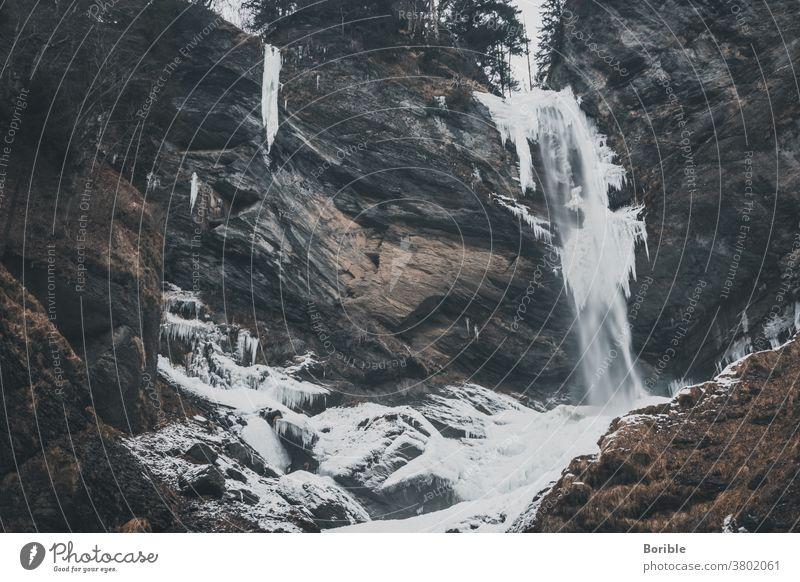 Frozen waterfall Water Waterfall Winter Winter vacation Winter forest winter hiking Snow Snow layer Cold Forest sarganserland berschis frozen Dangerous mood