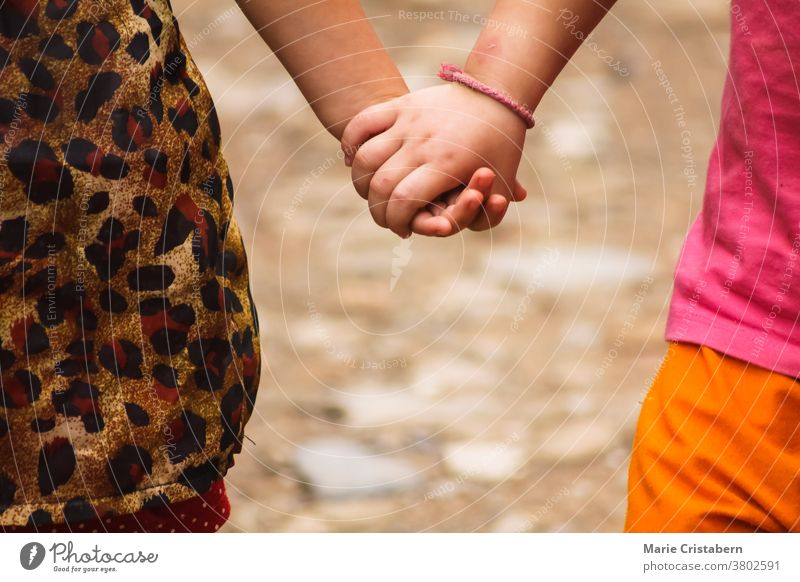 Close up of kids holding hands day childcare symbol hold hands friends joy unity innocence summertime safety beautiful happiness diversity caucasian brown skin