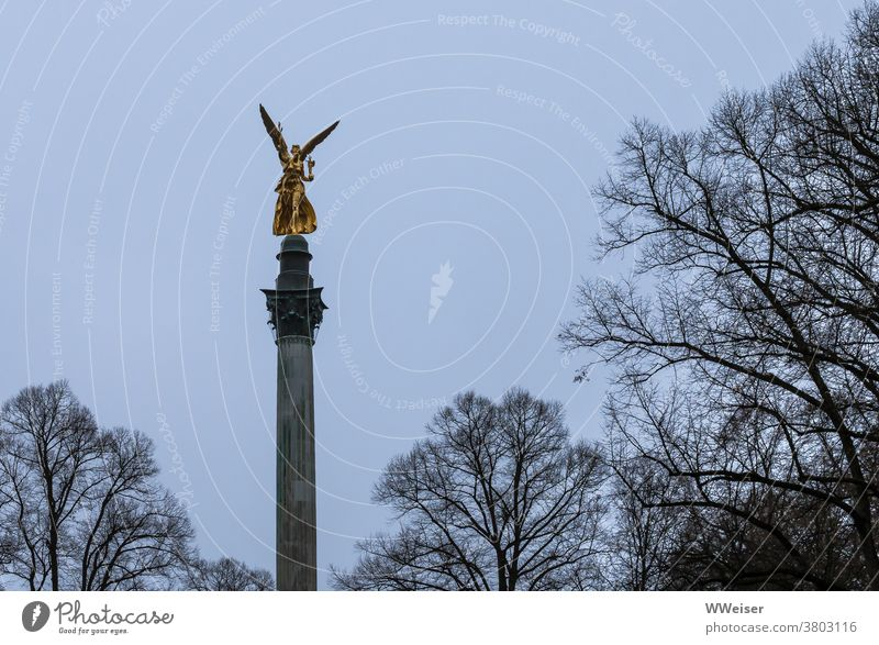 The angel of peace rises golden into the grey November sky Munich Peace Memorial Angel of peace Monument Bavaria War Figure Angel figure Bogenhausen Sky Park