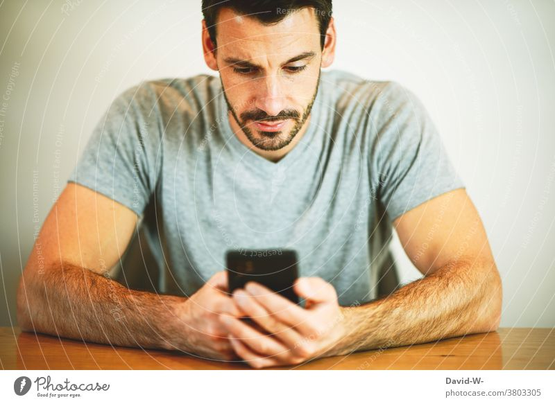 Man completely fixated on his cell phone Cellphone fixed concentrated Addiction hands Human being