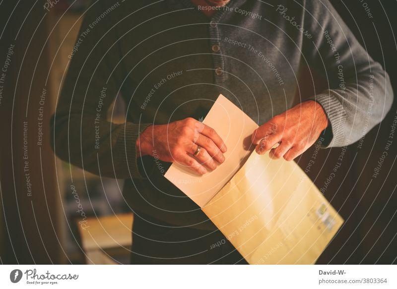 Man opens a letter Letter (Mail) Information Communication message Answer Result Envelope Envelope (Mail) Hand