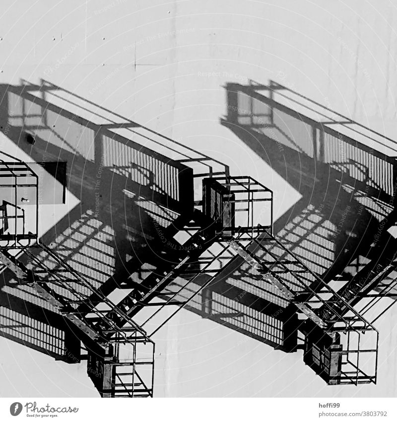 surreal shadow play of an emergency staircase Shadow play Abstract Light Stairs External Staircase Escape route Architecture Banister Structures and shapes