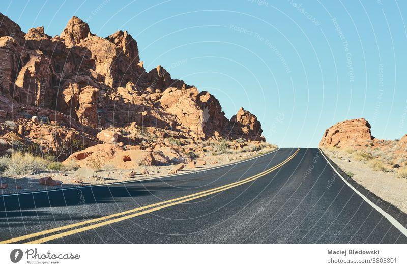 Panoramic view of Nevada desert road, USA. travel vintage highway adventure America retro filtered sky journey landscape scenery drive asphalt photo nature trip