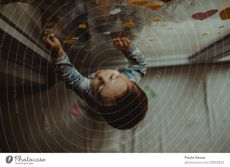 Toddler playing at the window at home Caucasian stay at home Infancy Quarantine Authentic Interior shot Interest Face Child Colour photo Boy (child)