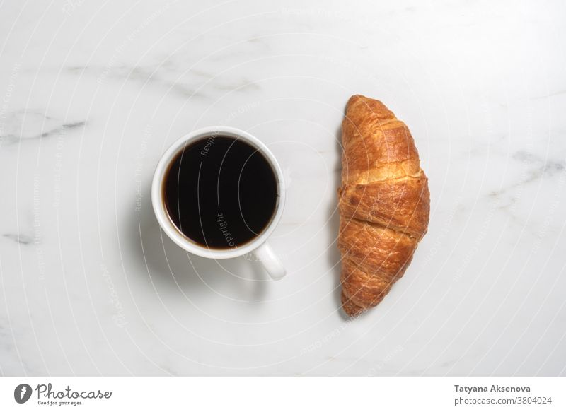Fresh baked croissant and coffee breakfast food french morning pastry espresso drink cup bakery cafe marble no people