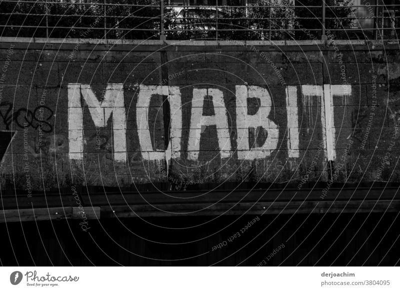 In large white letters on dark background, well visible from the Landwehrkanal. It says : MOABIT . Characters Letters (alphabet) Signs and labeling Signage