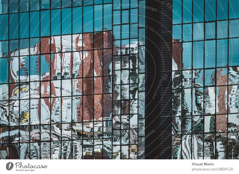 Abstract reflections on the glazed facade of an office building abstract windows urban architecture edifice frontage structure geometric design modern rows blue