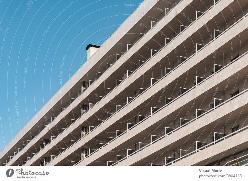 Rows of balconies of an urban contemporary building in diagonal view facade architecture metropolitan edifice structure geometric abstract design modern rows