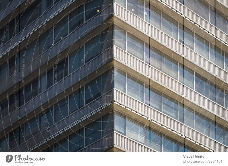 Symmetrical view of the corner of a residential building covered with a mesh facade windows urban architecture balconies edifice structure geometric abstract