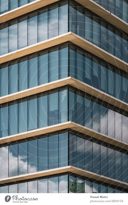 Symmetrical view of the corner of an office building with vertical glazed windows facade symmetrical abstract urban architecture edifice frontage structure