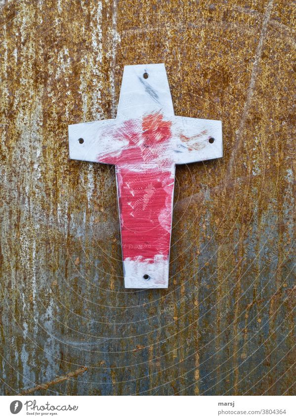 Red smeared cross against a rusty background Christian cross Religion and faith Crucifix Old Easter Good Friday corroded tranquillity Hope Symbols and metaphors