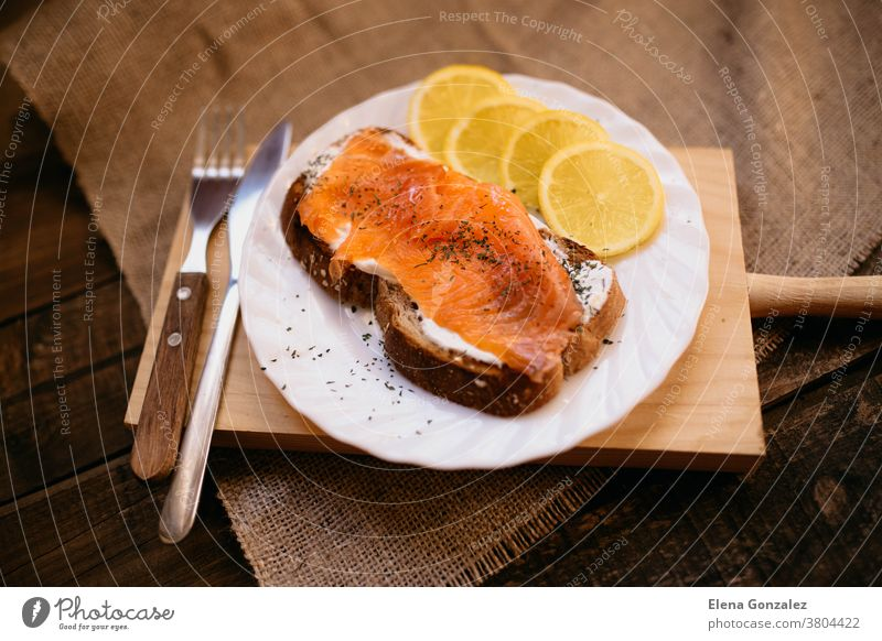 Smoked salmon with cheese toasted bread lemon and yogurt dip smoked smoked salmon cream cheese crostini prepared served slice plate dish table meal breakfast