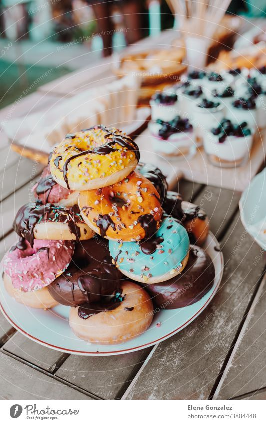 Delicious Donuts cake with chocolate topping. Festive family or party snack concept. Overhead view. donut Cake Topping Yummy Celebration birthday delicious