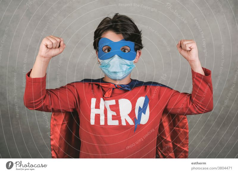 Coronavirus,kid with medical mask dressed as a superhero coronavirus child covid-19 epidemic pandemic quarantine stay home 2019-ncov happy happiness lifestyle