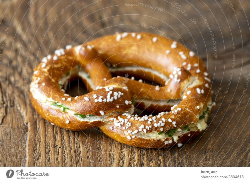 Bavarian pretzel with butter on wood Pretzel butter pretzel Butter Bread Germany Snack Fresh Breakfast Delicious Coffee background Meal snack Eating Table