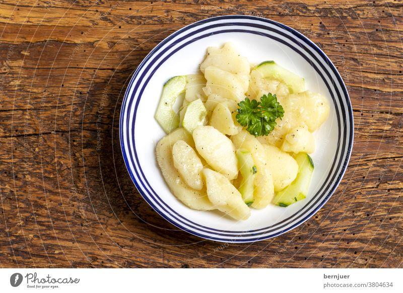 Bavarian potato salad Lettuce supervision Wood Rustic Parsley Vinegar Cooking oil Fresh Eating Green Dressing Vegetable Onion bowl spices Appetizer tribunal