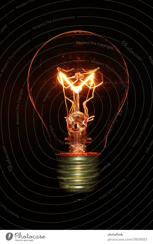 Incandescent lamp Bulb in front of black background light bulb Electric bulb Light Dark darkness stream Energy Electricity Energy industry Renewable energy