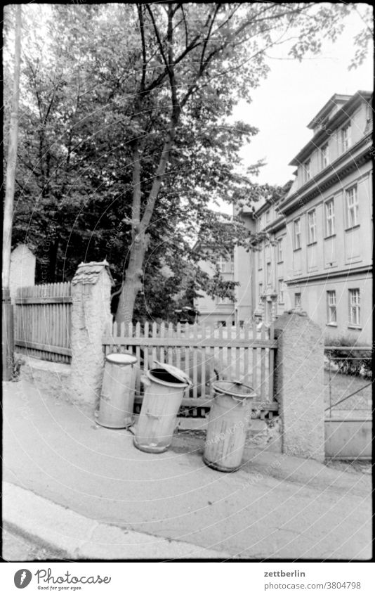 Three waste bins Trash dustbin Refuse disposal Disposal dwell Residential area House (Residential Structure) Apartment Building obliquely slanting Downward