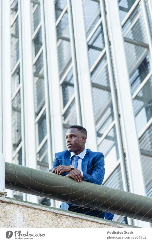 Stylish executive black man in suit in downtown businessman confident formal urban respectable modern success elegant manager professional adult male