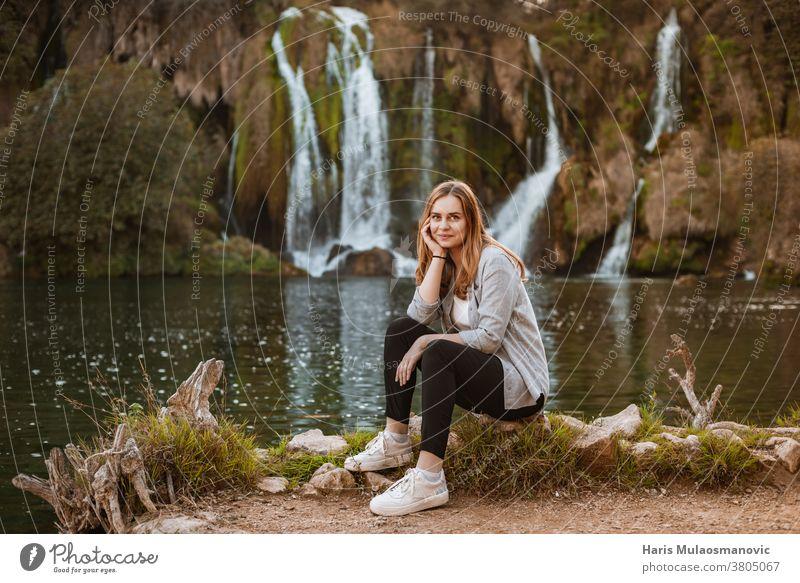 Beautiful blonde woman enjoying the nature near scenic waterfalls attractive balance beautiful beauty enjoy life enjoy nature explore female forest freedom