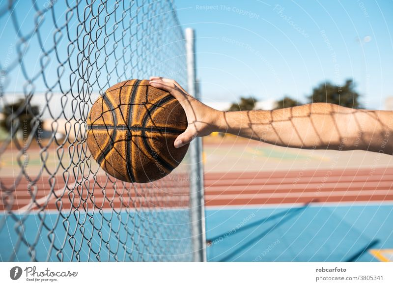 man playing basketball an outdoor court on the street. fun sport urban people cool men shot young game male adult jump hoop score competition leisure african