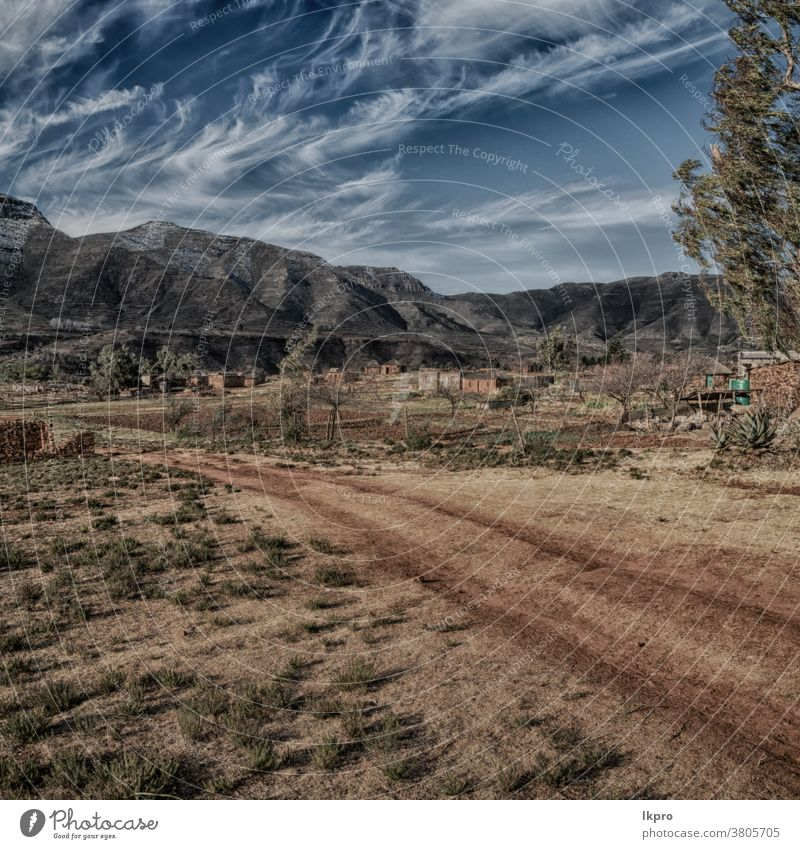 in lesotho  street village near  mountain africa south landscape drakensberg sky pass nature rural green road kingdom travel maluti blue sani african view snow