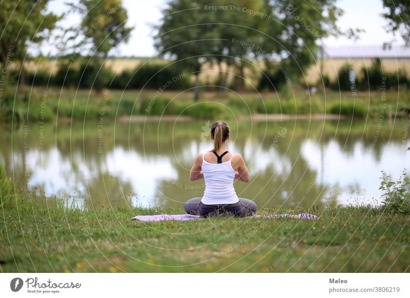 Yoga exercises outdoors / A young girl / Portrait brunette Fitness grass Model Park person picnic portrait pretty relaxation romantic sensuality smile Sports
