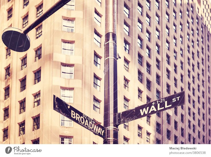 Wall Street and Broadway street sign in Manhattan, New York, USA. city retro vintage symbol building America NYC business financial district famous downtown