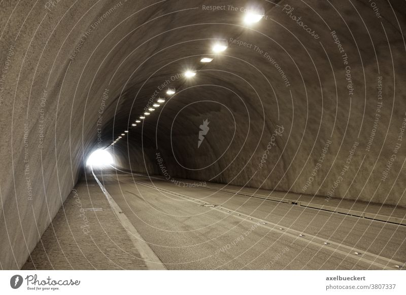 empty illuminated car or road tunnel car tunnel street underpass underground passageway traffic light transportation travel subway cement copyspace copy space