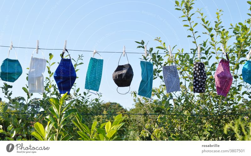 self-sewn masks as face masks in the corona crisis hang on the clothesline to dry after washing | corona thoughts Mask Face mask Respirator mask Protection