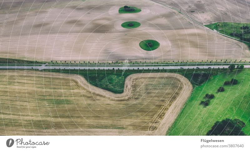 From above 4 Above aerial photograph drones droning UAV view Field Margin of a field Working in the fields Tracks Tracking track search Lanes & trails Grain