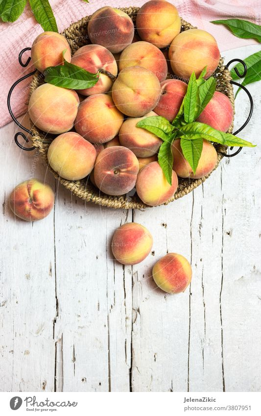 Ripe juicy peaches on a rustic background fruit food healthy fresh agriculture diet organic summer raw red sweet nectarine ripe group nutrition vitamin harvest