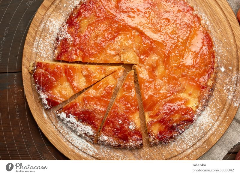 baked round apple pie on wooden board a above american sweet table tart tasty thanksgiving top traditional whole autumn brown cake closeup delicious dessert