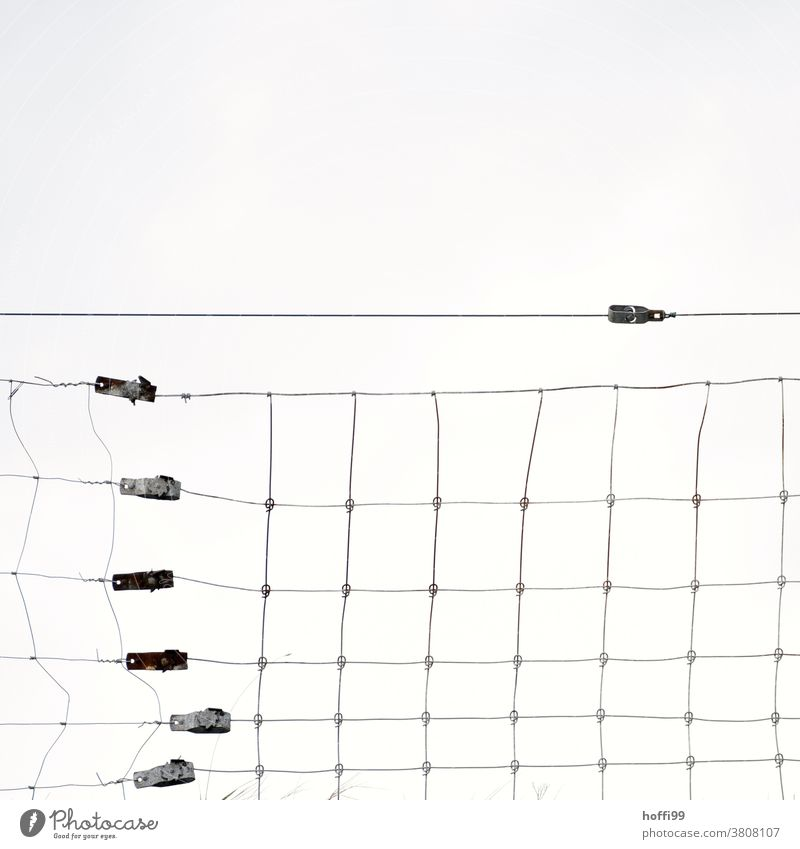 Fence on a dike with distorted wires Barrier Wire Wire fence Broken Wire netting Wire netting fence Barbed wire Safety Protection dike top Wiry