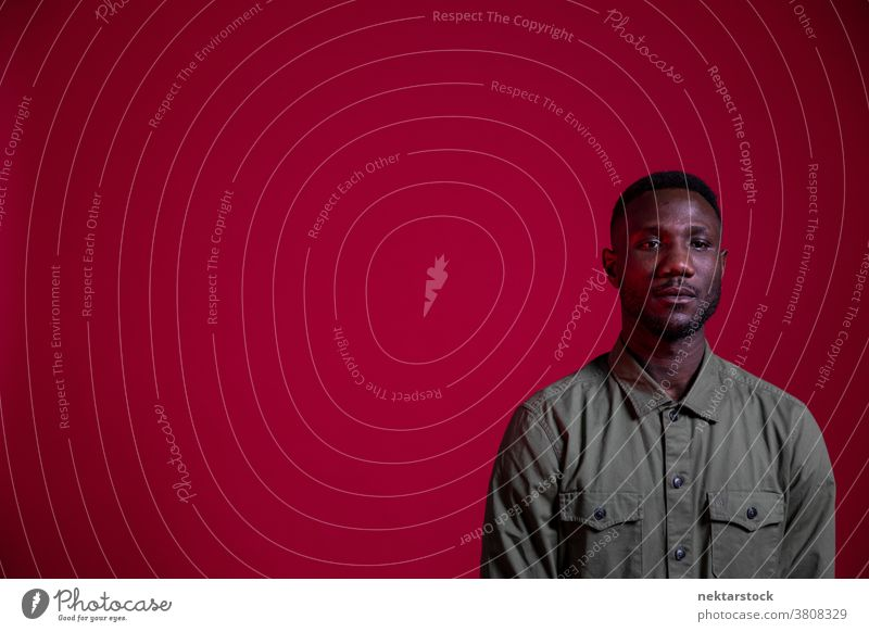 Young Black Man Posing in Studio on Isolated Red Background man black copy space portrait African ethnicity one person male one man only 20-30 years old