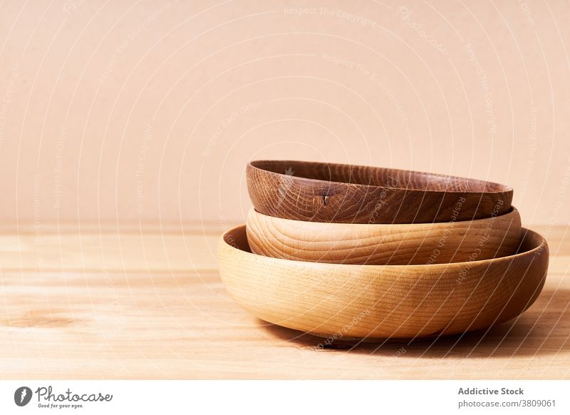 Wooden bowls in studio plate wooden still life copy space object minimal composition kitchen utensil pastel household board empty nobody brown texture table