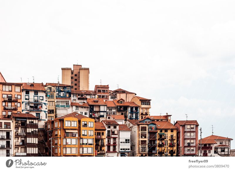 Small pintoresque village against a white sky small landscape cityscape copy space colorful colors buildings spain basque basque country vizcaya house warm