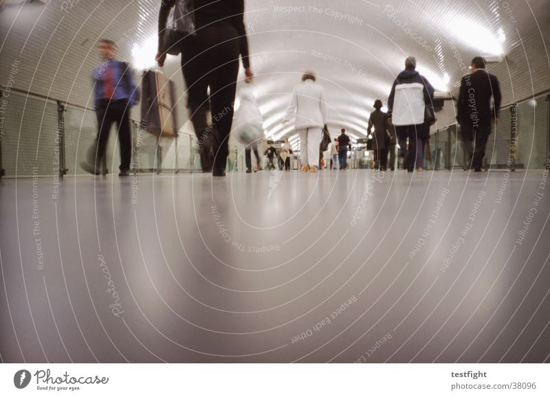 Human being City Movement Transport Floor covering Underground Train station London London Underground Portugal Haste Commuter trains Lisbon Underpass