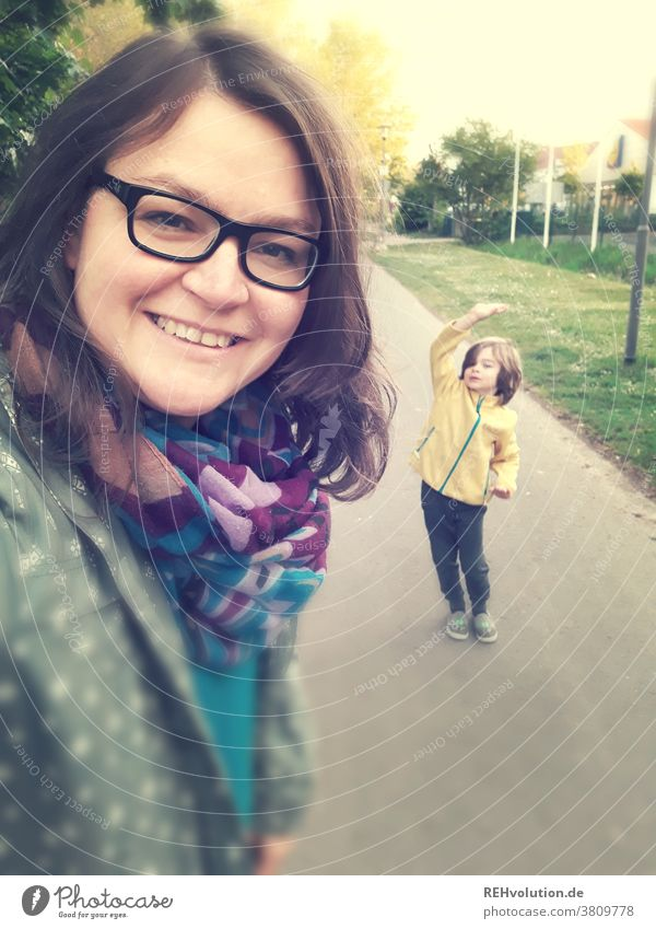 Selfie from a mother and son Woman Exterior shot Human being Cellphone Smiling Easygoing Adults Happy pretty portrait Joy Lifestyle Child To go for a walk