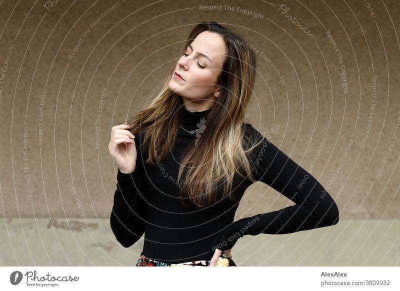 Lateral portrait of a young woman with closed eyes Woman 18 - 30 years pretty fit Slim smart kind Pleasant Attractive Brunette Long-haired salubriously Fresh