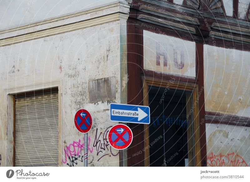 HO here and earlier ho Facade Past Old building Lettering Corner Road sign Authentic Weathered Half-timbered facade One-way street No standing roller shutter