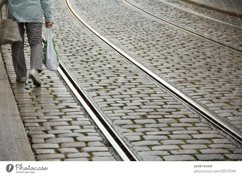 back from shopping, everything does not come in the bag Street Cobblestones rail Traffic infrastructure Legs Shopping bag Going Pedestrian