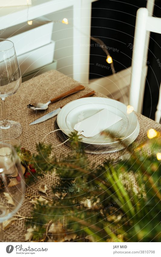 Holiday Gold place setting,  Christmas table with ornaments and natural pine branch on the livingroom home christmas thanksgiving menu food happy decoration