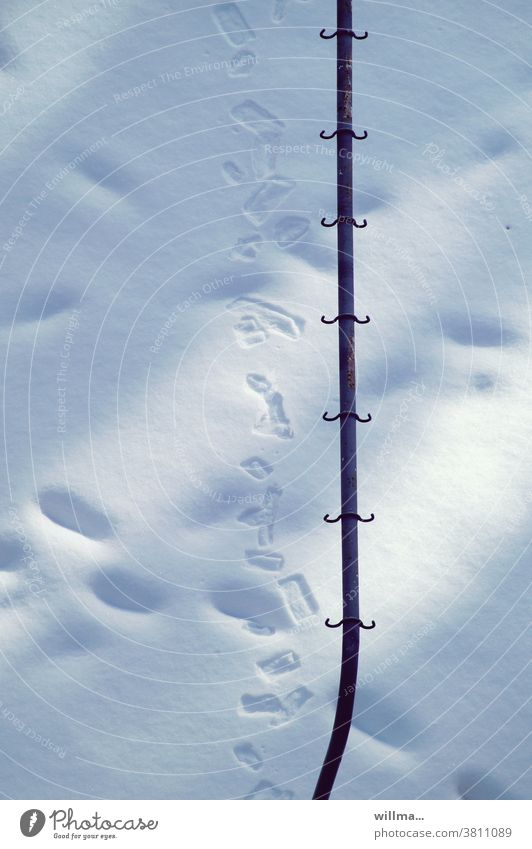 winter migration of extraterrestrials Snow Winter Tracks clothes pole Checkmark Frost sunny Thaw footsteps
