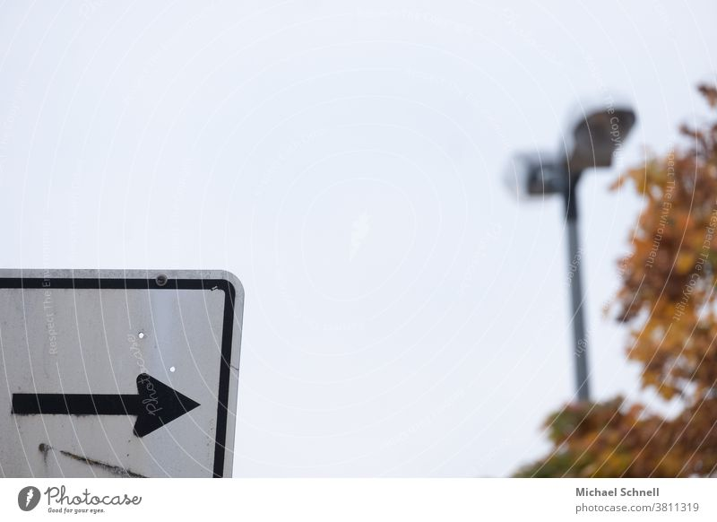 To the right? Arrow Direction Right Signs and labeling Signage Road marking Orientation Clue Indicate Recommendation