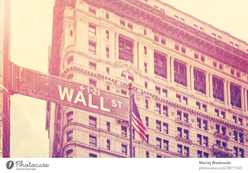Retro stylized picture of Wall Street, New York, USA. street sign city retro vintage symbol building America NYC business Manhattan financial district famous