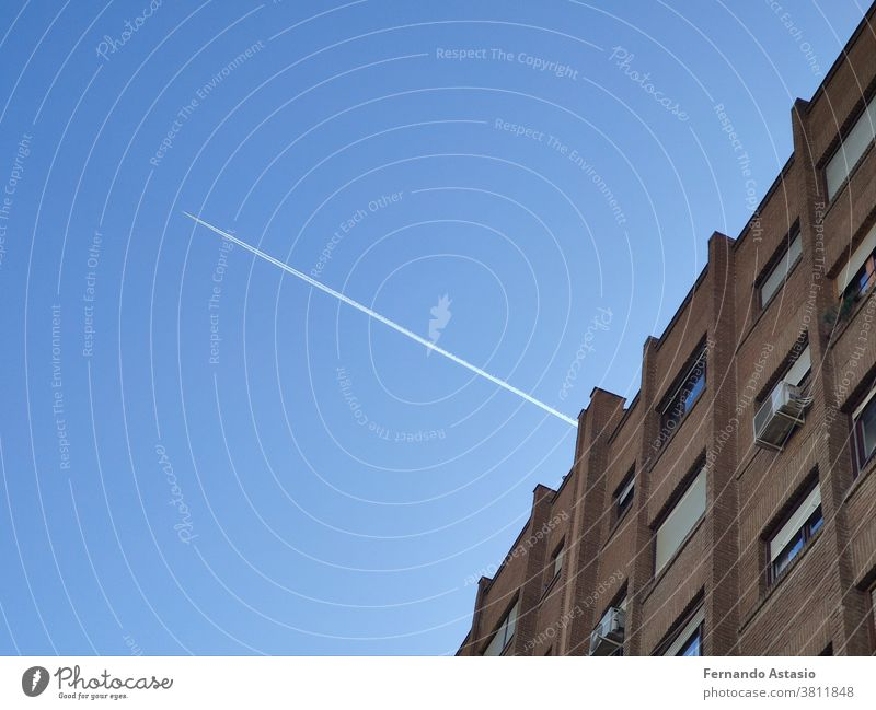 The white flash of the plane appearing through the building causing the lines to be cut, in Madrid, Spain architecture sky skyscraper city office construction