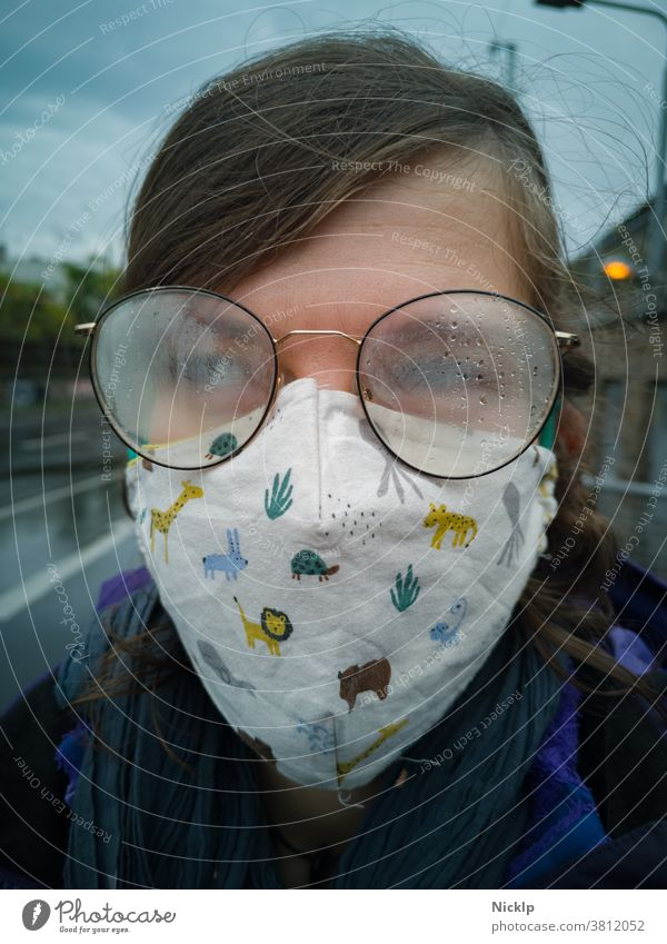 young woman wearing a mask and fogged glasses in autumn / winter (Corona / Covid-19) Young woman Mask Mask obligation Hygiene regulation covid-19 COVID